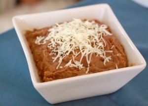 http://www.100daysofrealfood.com/2011/08/29/recipe-easy-slow-cooker-refried-beans/